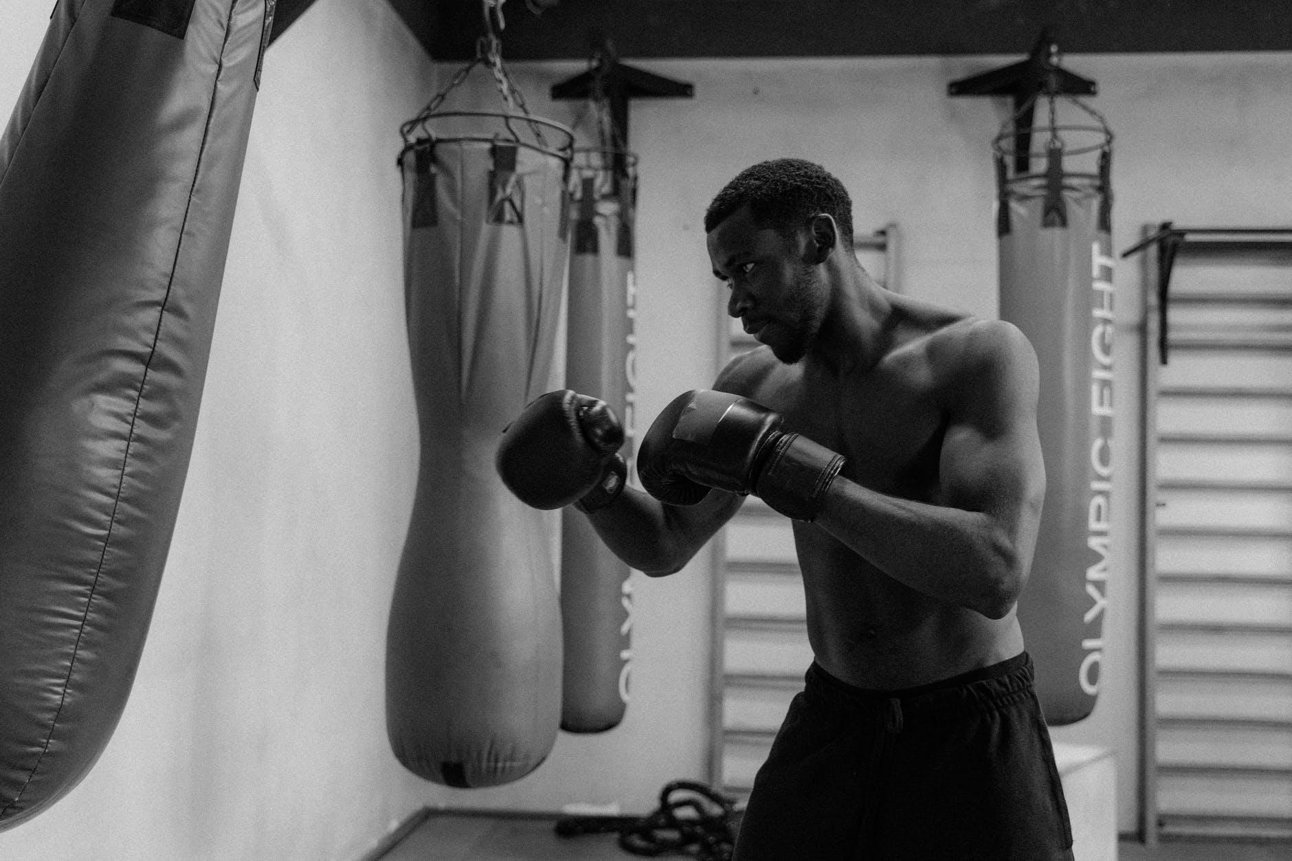 topless man wearing boxing gloves